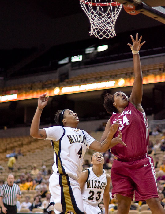 Missouri women's basketball forward Jessra Johnson, left, fails to prevent Oklahoma's center, Abi Olajuwon, from making a two point shot on Wednesday, 20 Jan. 2010 at Mizzou Arena in Columbia, Mo.